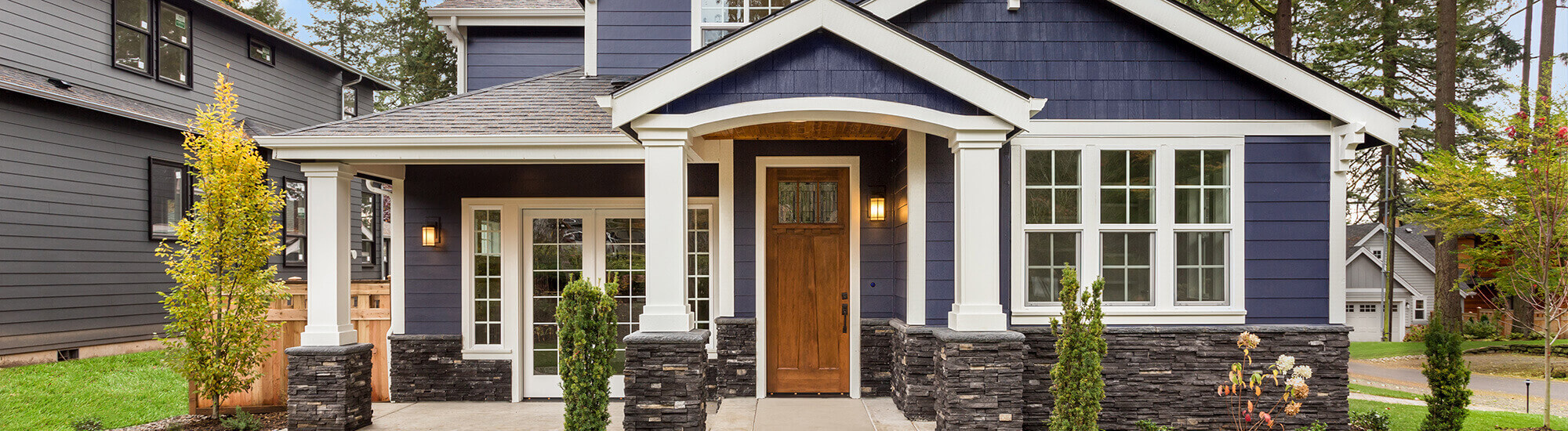 The front of a Blue House with windows and door installed by Kempenfelt Windows & Doors