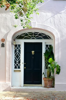 a black door with white trim