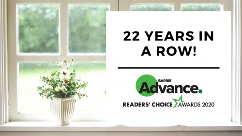 """a window with a flower pot on the left side. On the right, a white square with the words """"22 years in a row. Barrie readers' choice award"""""""